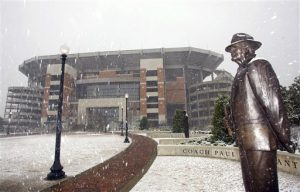 "Snow falls on a statue of former University of Alabama football coach Paul ""Bear"" Bryant in front of Bryant-Denny Stadium on the University of Alabama campus in Tuscaloosa, Ala., Sunday, March 1, 2009. A rare March snow has blanketed much of Alabama and winter storm warnings are in effect along the U.S. East Coast. (AP Photo/Tuscaloosa News, Dan Lopez)"
